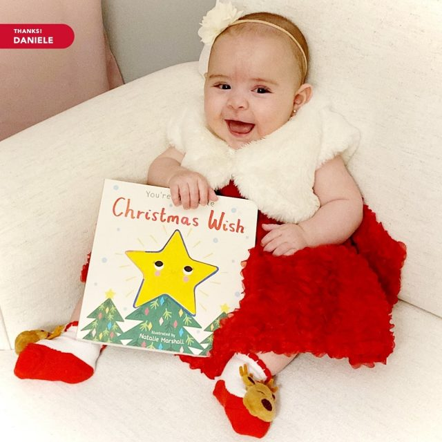 """""""She doesn't know, but she was my wish last year! We're starting our first family tradition this Christmas; we will be singing along with this book every night in December. She giggles and smiles every time, and the book will be a keeper for years to come.""""   Thank you for spreading holiday cheer by sharing this moment with us, Daniele N. Your daughter is adorable.   #maryvilleonline #maryvilleuniversity #maryvilleu #happyholidays #merrychristmas #holidaycheer #christmaswish"""