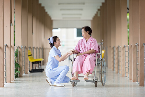 A nurse communicates with her patient.