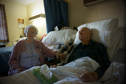 A hospital patient and his wife.