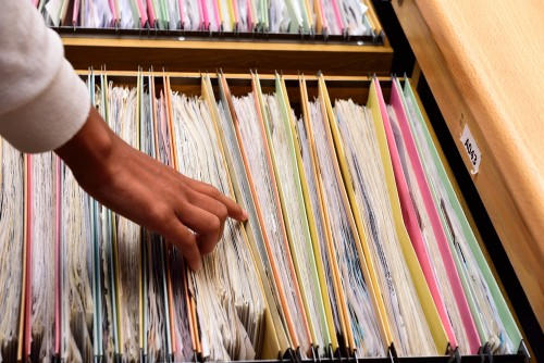Thumbing through file folders in admissions or registrar's office